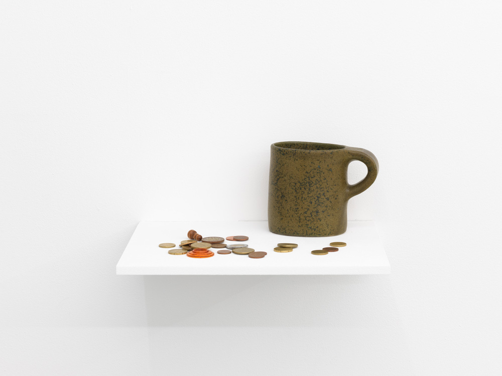 Petra Feriancová, Survivals, Relics, Souvenirs, 2015. Ceramic mug, coins and other objects.